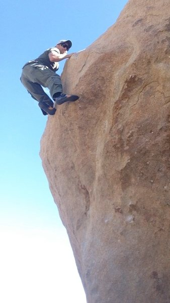 This is a really fun boulder problem right on the road in the Tombstone area. Probably a v3-4.
