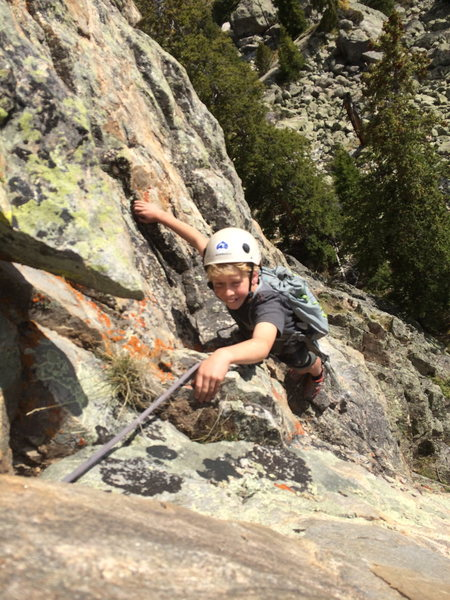 Wheeler sending the crux P6 on the west face of Wild Tower.