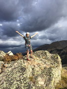 Rock Climbing Photo: Wheeler on the summit of Wild Tower, thunderheads ...