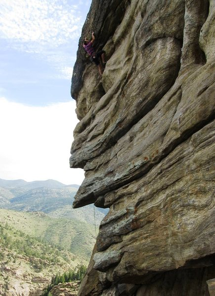 The redpoint crux consists of a few strenuous cranks to clear the slightly overhanging headwall.