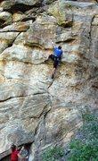 Rock Climbing Photo: A long stab mid-way through the crux.