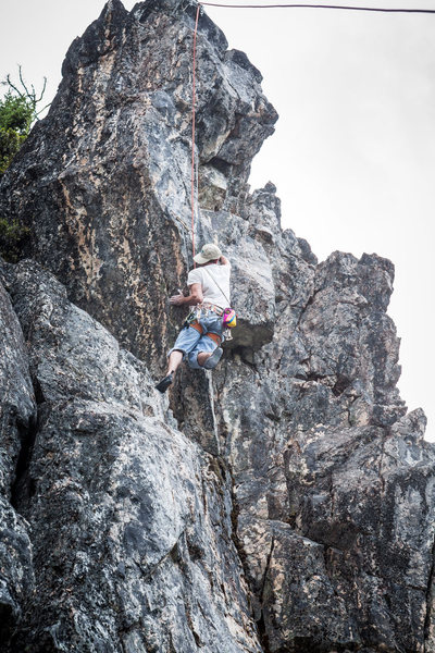 Rock Climbing Photo: Ben stepping onto the arete on Size 11 and Size 12