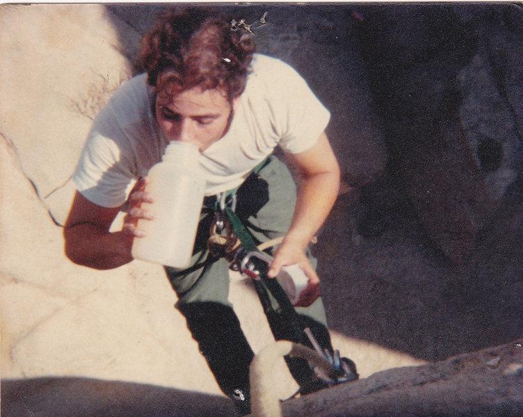 Danny taking a break on the Headstone Bolt Ladder in 1979. The ladder was fun climbing using  a cliff hanger move at the top. The ladder was chopped in the early 80's. Once a great practice route  for aid climbing .<br>