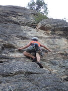 Rock Climbing Photo: Climber approaching the lower crux of Opti-Mystic.