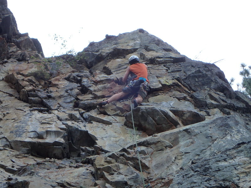 Climber approaching the crux of Abraxas