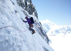 Rock Climbing Photo: J.D. Merritt traverses on some terrain between the...