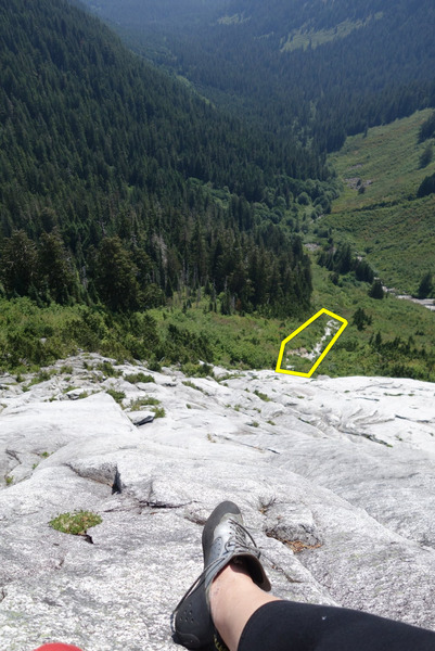From belay station of first pitch. Rocky area highlighted shows the part of the approach after coming out of the brushy tunnel.