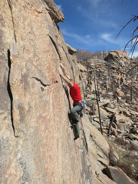 Mike Anderson nears the end of the crux section on The Spark. These bolts were added after the FFA because my drill battery died on the FA, and I'm impatient.