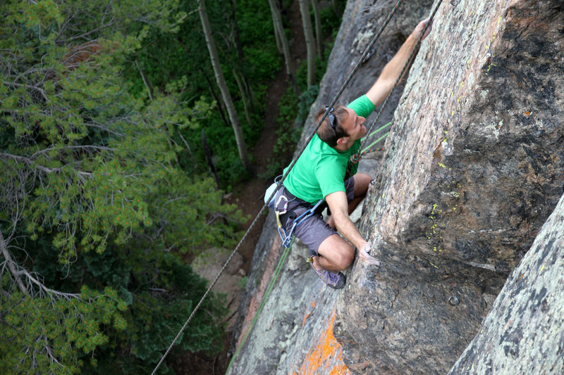 J. Weingast on the 5.12a crux arete.
