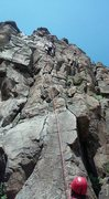 Belaying my son up the route.