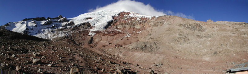 "Panoramic photo of Chimborazo from the Whymper Hut. The Standard Route heads left to an ice shelf below ""The Castle"", traverses right, and onto the glaciated ridge to the summit."