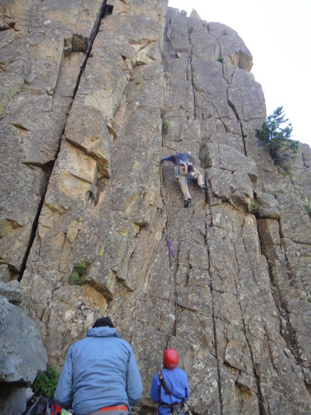 Can climb dihedral crack (my left hand) or crack on right (my right foot), or both.<br> <br> Photo by Mark Hudson.