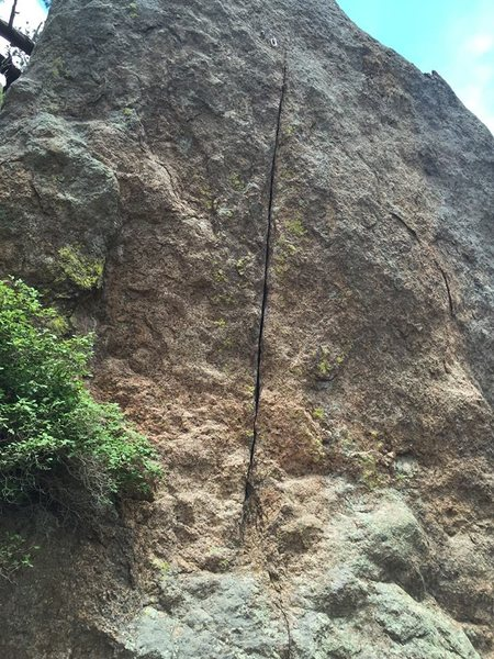 This is a 25 foot finger (to smaller than finger) crack with a piton 3 feet from 2 newly drilled bolts with hangers.   It is located about a mile up the trail on the north side, facing west.