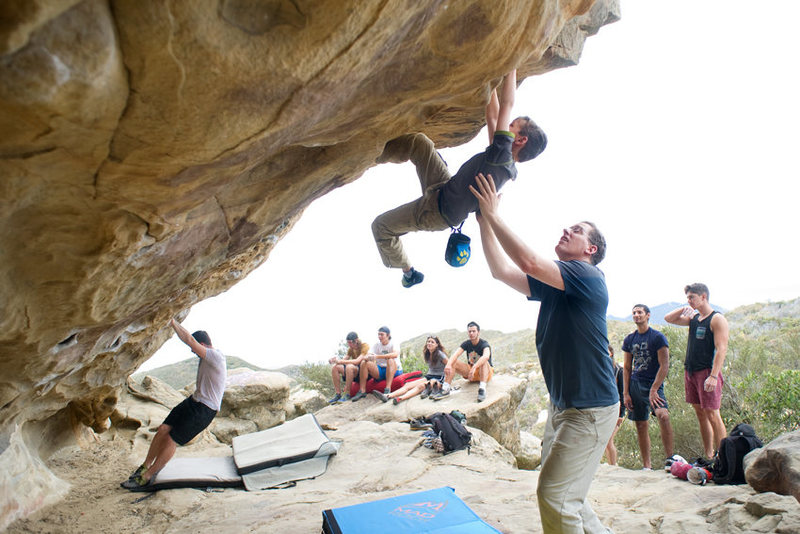 Bryson Fienup works the classic traverse during a busy weekend at Lizard's Mouth.