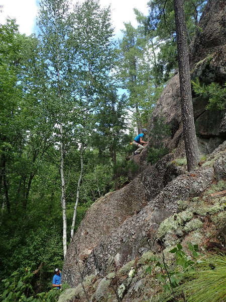 Michelle leads Slabbatical with Dustin on belay.
