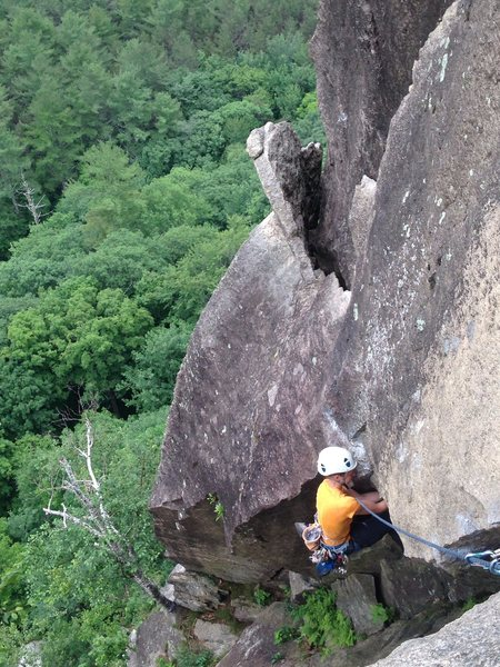 Torie doing the step down to the chimney after the beast flake belay