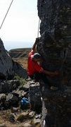 Rock Climbing Photo: The crux move on Pelican Arete.  A right hand side...