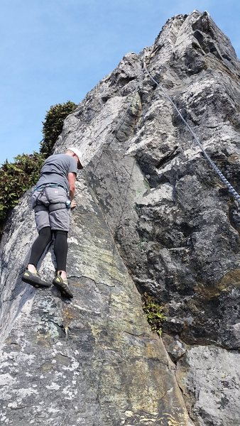Paul Hutchenson on German Chocolate Cake.  He is staying on the arete to where it joins the main face.  Then step right and up.  There is a fun match feet to hands at the top of the arete.