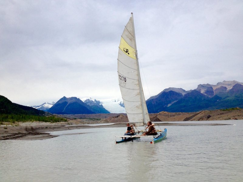 Bush pilots, Jason Lobo and Jay Claus sailing on the newly formed lake at the toe of the Kennicott Glacier.