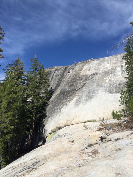 First view of Dark Side Dome when approaching from slabs below. Climbers on 5.8 routes.