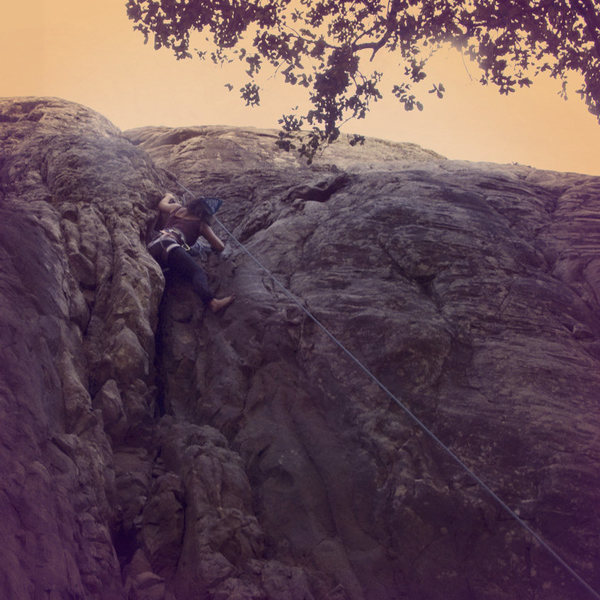 Climbing Crack Wall barefoot at Bishop Peak.