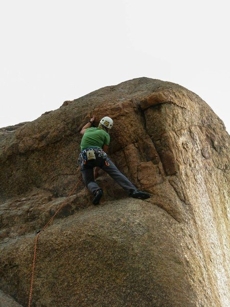 Pulling the crux on the first ascent.