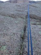 Rock Climbing Photo: The thin crack and bolt near the bottom.
