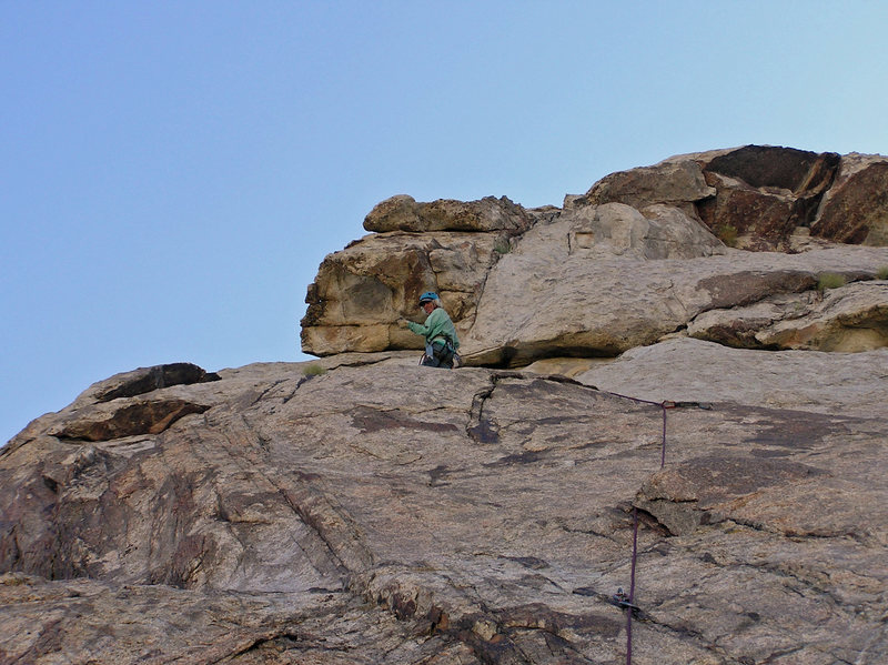 Shawn belaying from the top of p2