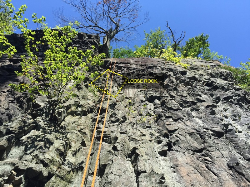 Top roping the walls just south of the tower.  This was one of only a few areas not covered in poison ivy.  <br>