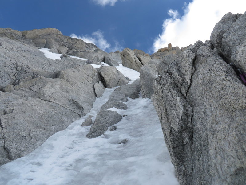 the upper ice pitch can be avoided by crossing the rocks to the right and accessing the upper snow face