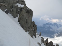 Rock Climbing Photo: traversing out to the SE Ridge and heading for the...