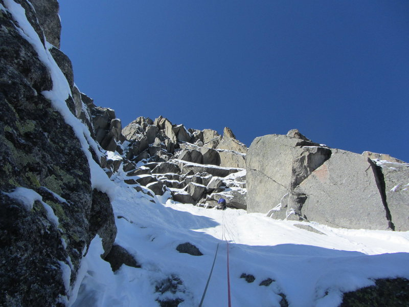 The route goes to the right of the ridge at one point and then goes back left to exit onto the snow ridge above