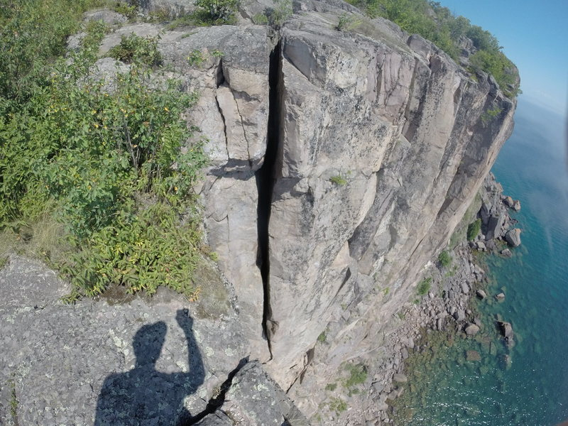 The route starts at the ledge and at its lowest point is 3.5 inches wide, becomes 9 inches, and after the ledge mid-route is 15 inches wide (narrowing to 13 inches at some points).
