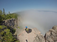 Rock Climbing Photo: Brian preparing to rappel down Gun Fight as fog ro...
