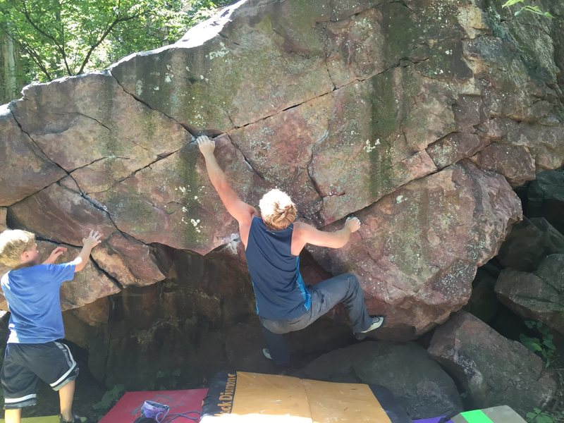 Middle of Boulder start on razor sharp right crimp and left hand thumb pinch. Make big move to incut left find your feet one more throw and mantle the top.