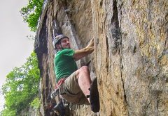Attempting Twisted Sister 5.11d at the Bird