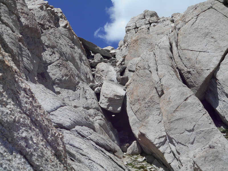 The chockstone in the third chute. Nearly snow free in late July, 2015.