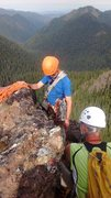 Setting up the rappel from the summit ridge with some of the nice view behind.