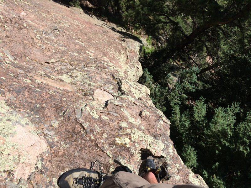 "Looking down the crux ""2 moves"". Seemed a bit thin for the 5.0-5.2 rating, but it was short."