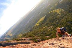 Rock Climbing Photo: Joey free soloing the Third Flatiron at sunrise