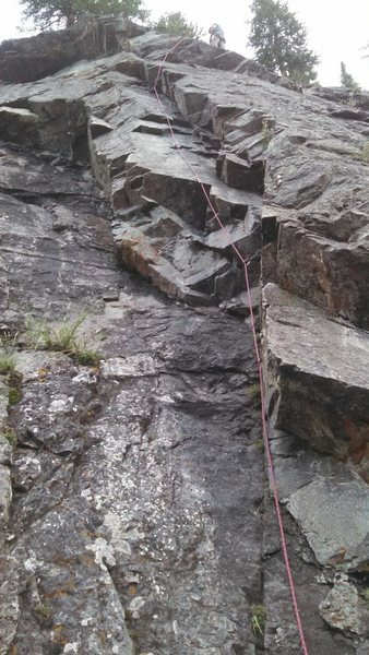 Just about at the anchors in this shot. You need to swing to the left arête after the roof. Very fun move.