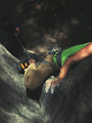 Rock Climbing Photo: Throwing in the knee bar.