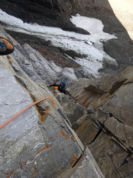 Looking down the steep cracks at the end of the second pitch.