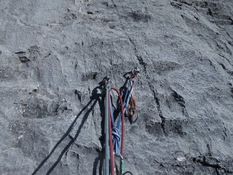 Typical of the bolted anchors on the Gmoser route. I found them sometimes difficult to locate in a sea of similar coloured limestone.