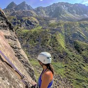 Rock Climbing Photo: Jess rapping down Thin As Ice in the foreground, w...