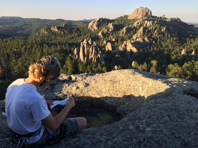 Checking out the Summit Register after scrambling up the South side of Pine Tree Rock.