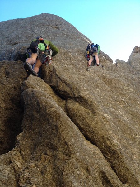 Brandon Emery and John Lang beginning the free solo of the conn route