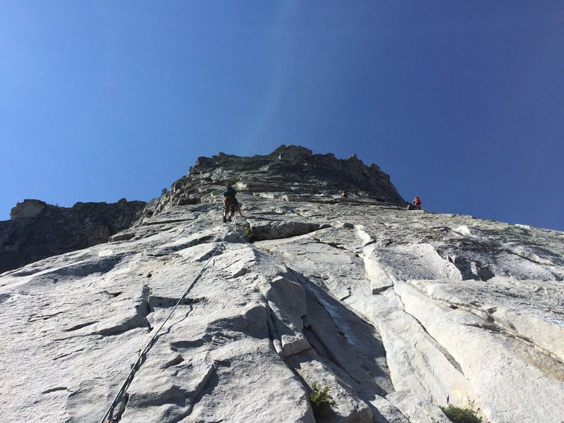 Leading the third to last pitch on NW Buttress of Tenaya Peak.