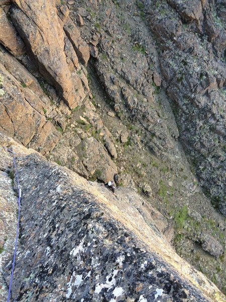 Jess face-arete climbing on pitch 1 of Timeless