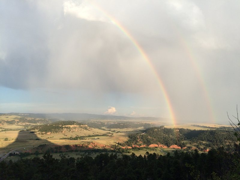 Double rainbow above the shadow of Devils Tower after climbing on Assembly..